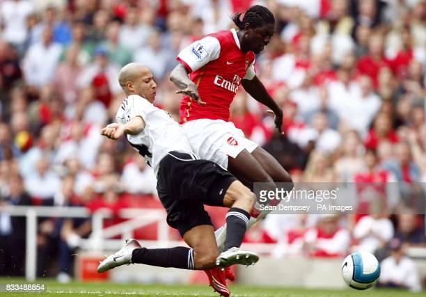 Derby County's Tyrone Mears slides in to make a challenge on Arsenal's Emmanuel Adebayor