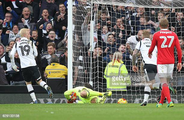 Derby County's Will Hughes scores his sides third goal beating Nottingham Forrst's Vladmir Stojkovic during the Sky Bet Championship match between...