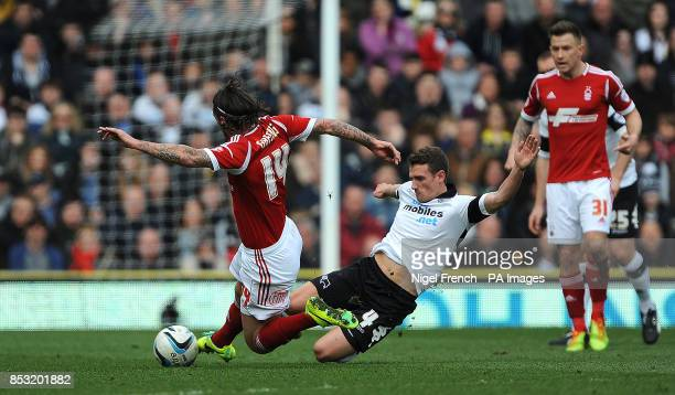 Derby County'sCraig Bryson and Nottingham Forest's Jonathan Greening battle for the ball during the Sky Bet Championship match at the iPro Stadium...