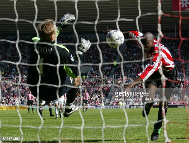 Derby keeper Mart Poom denies Sunderland's Patrick Mboma with a point blank save during the FA Barclaycard Premiership game at The Stadium of Light...
