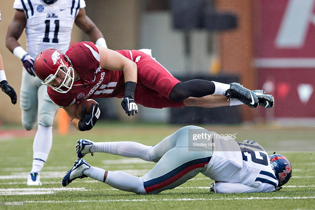 Derby of the Arkansas Razorbacks is tackled in the second quarter by Tony Conner of the Ole Miss Rebels at Razorback Stadium on November 22 2014 in...