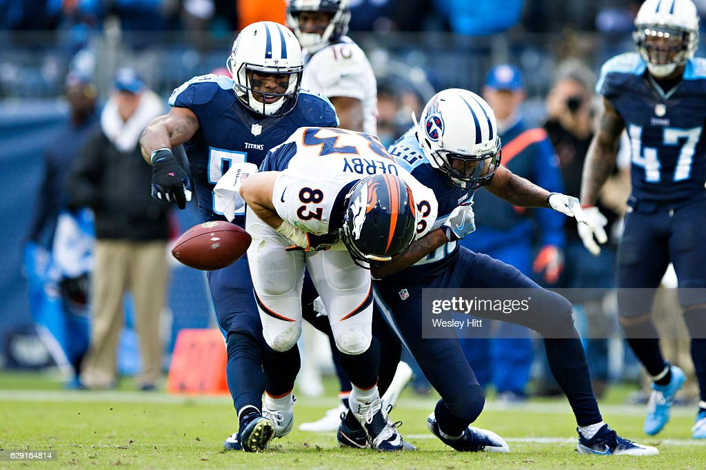 A.J. Derby #83 of the Denver Broncos is hit after catching a pass by Chris Harris Jr. #25 of the Tennessee Titans and fumbles the ball near the end of the game at Nissan Stadium on December 11, 2016 in Nashville, Tennessee. The Titans defeated the Broncos 13-10.