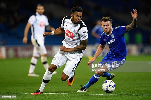 Derby player Cyrus Christie and Joe Ralls of Cardiff compete for a ball during the Sky Bet Championship match between Cardiff City and Derby County...