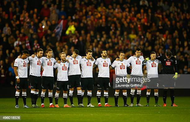 Derby players remember fallen members of the armed forces prior the Sky Bet Championship match between Nottingham Forest and Derby County at City...