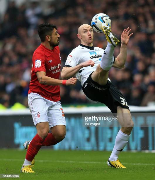 Derby's Conor Sammon and Nottingham Forest's Gonzalo Jara battle for the ball during the npower Championship match at Pride Park Derby