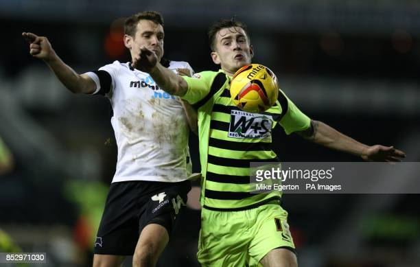 Derby's Craig Bryson and Yeovil's Joe Ralls during the Sky Bet Championship match at the iPro Stadium Derby