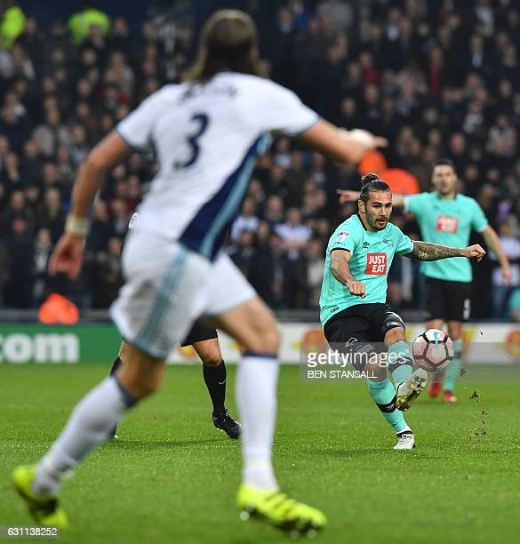 Derby's English midfielder Bradley Johnson passes the ball during the English FA Cup third round football match between West Bromwich Albion and...