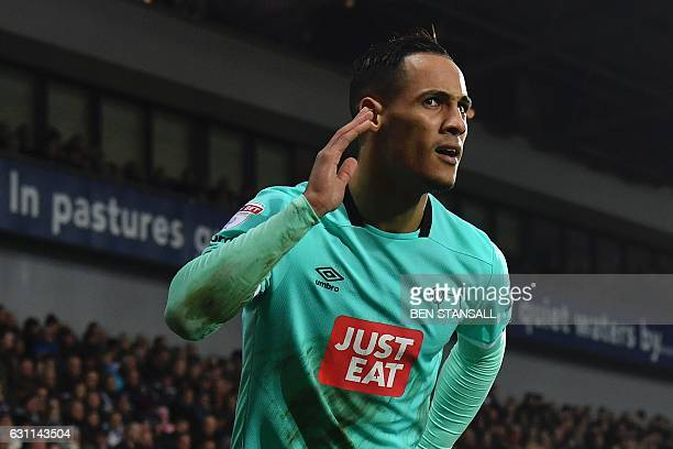 Derby's English midfielder Tom Ince celebrates scoring their second goal to take the lead 12 in the English FA Cup third round football match between...
