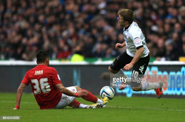 Derby's Jamie Ward and Nottingham Forest's Gonzalo Jara battle for the ball during the npower Championship match at Pride Park Derby