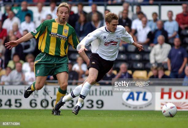 Derby's Lee Morris is chased down by Larus Sigurdsson of West Bromwich Albion during their Nationwide Division One match at Derby's Pride Park ground...
