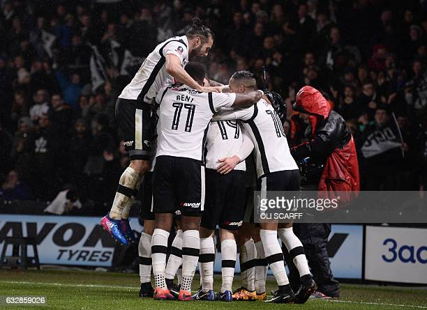 Derby's Scottish defender Craig Bryson celebrates with teammates after scoring their second goal during the English FA Cup fourth round football...