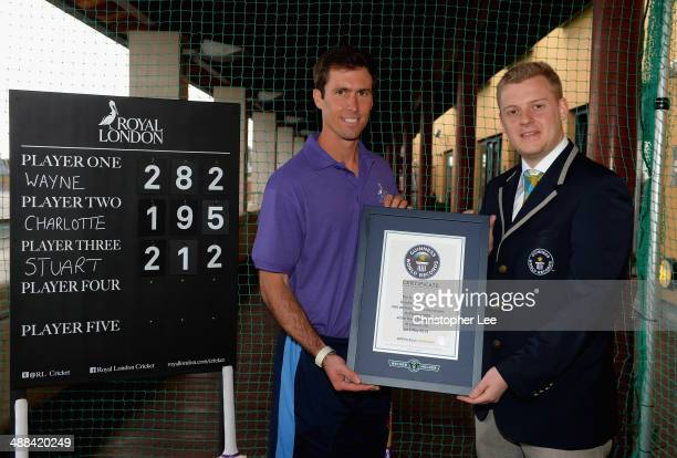 Derbyshire Captain Wayne Madsen is presented with his Guinness World Record Certificate by Tom Ibison for 282 Cricket Bat Touches in 60 seconds...