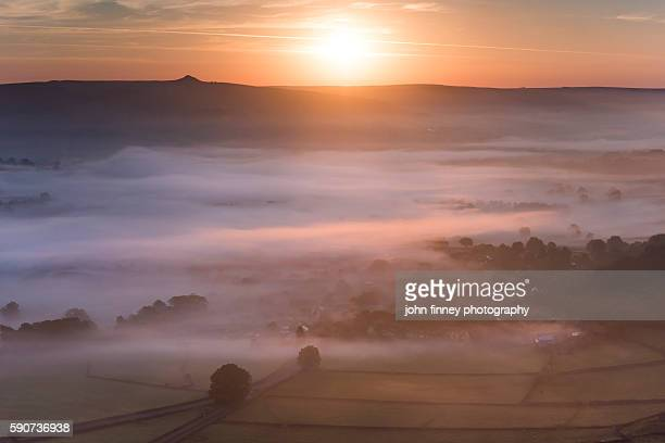 Derbyshire sunrise over beautiful misty valley. English Peak District. UK. Europe.