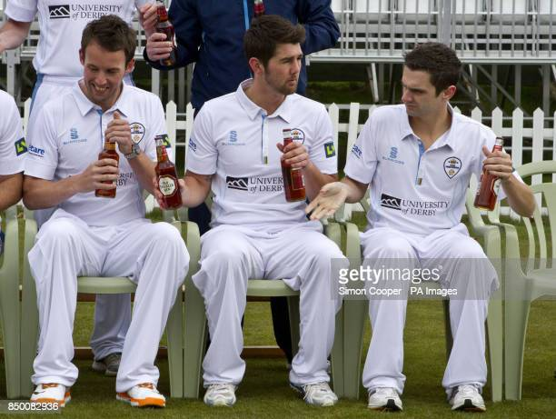 Derbyshire's Dan Redfern David Wainwright and Paul Borrington hand out bottles of Old Speckled Hen during the photocall at the County Ground Derby