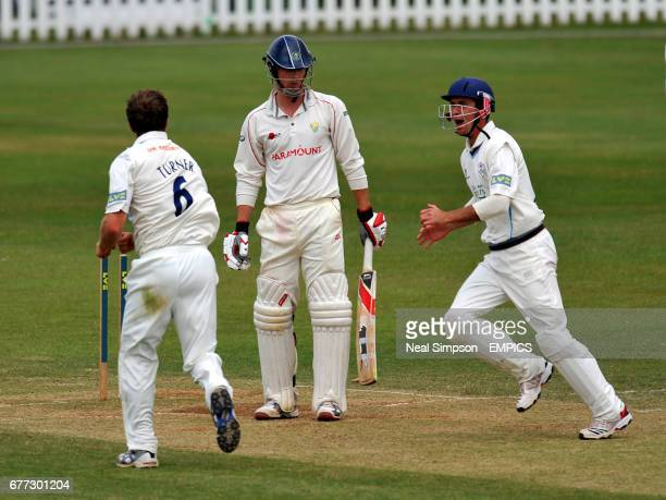 Derbyshire's Mark Turner celebrates bowling Glamorgan's James Harris as Wane Madsen rushes to congratulate him