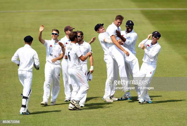 Derbyshire's Mark Turner celebrates taking the wicket of Indians' Shikhar Dhawan during day two of the Internationa warm up match at The 3aaa County...