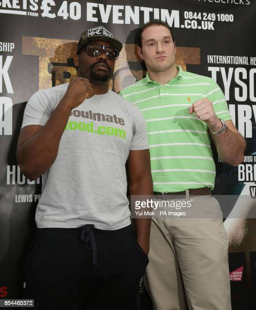 Dereck Chisora and Tyson Fury during the press conference at Fredericks Restaurant London