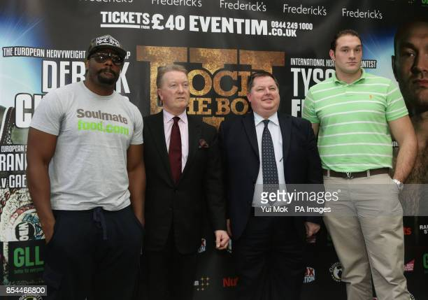Dereck Chisora and Tyson Fury pose with promoters Frank Warren and Mick Hennessy following the press conference at Fredericks Restaurant London
