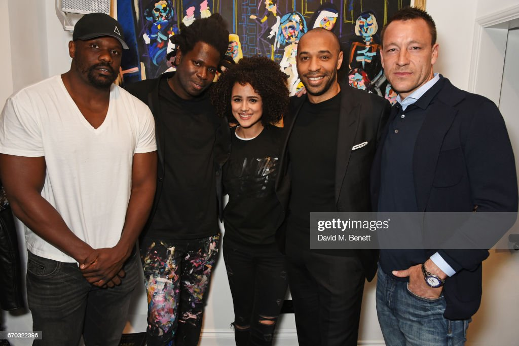 Dereck Chisora, Bradley Theodore, Nathalie Emmanuel, Thierry Henry and John Terry attend a VIP private view for New York artist Bradley Theodore at Maddox Gallery on April 19, 2017 in London, England.