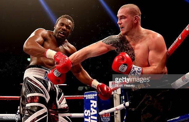 Dereck Chisora in action with Ondrej Pala during their WBO and Vacant International Heavyweight Championship bout at The Copper Box on November 30...
