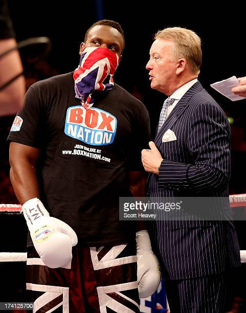 Dereck Chisora of England with Frank Warren prior to his Vacant WBO International Heavyweight Championship bout with Malik Scott of USA at Wembley...