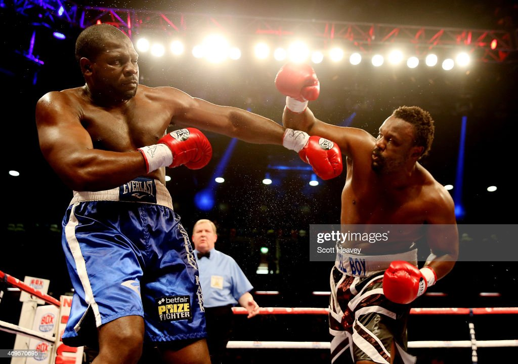 Dereck Chisora of Great Britain in action with Kevin Johnson of USA during their WBO and WBA International Heavyweight Championship bout at The...