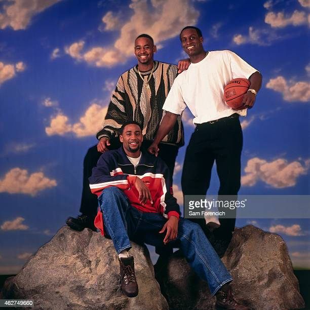 Derek Anderson Cedric Henderson and Brevin Knight of the Cleveland Cavaliers poses for a portrait during NBA AllStar Weekend on February 6 1998 in...