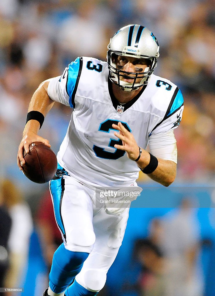 Derek Anderson #3 of the Carolina Panthers rolls out against the Pittsburgh Steelers during a preseason NFL game at Bank of America Stadium on August 29, 2013 in Charlotte, North Carolina.