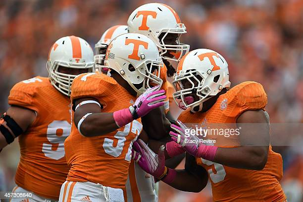 Derek Barnett celebrates with Brian Randolph of the Tennessee Volunteers following a turnover during a game against the Chattanooga Mocs at Neyland...
