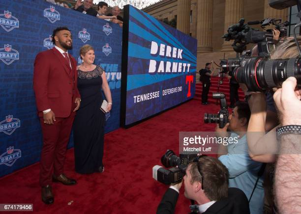 Derek Barnett of Tennessee poses for a picture with his mother Christine Barnett on the red carpet prior to the start of the 2017 NFL Draft on April...
