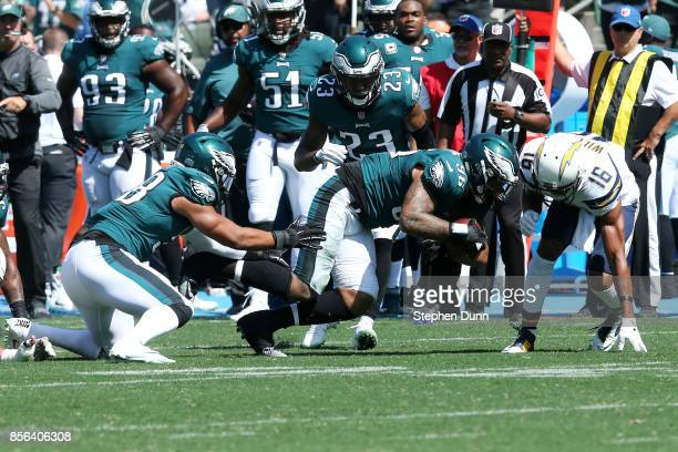 Derek Barnett of the Philadelphia Eagles attempts to run the ball after Los Angeles Chargers quarterback Philip Rivers is sacked and loses the ball...