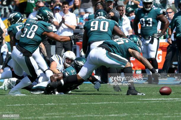 Derek Barnett of the Philadelphia Eagles recovers the ball after Los Angeles Chargers quarterback Philip Rivers is sacked and loses the ball during...
