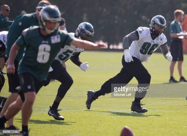 Derek Barnett of the Philadelphia Eagles runs down the field on a kickoff by Caleb Sturgis of the Philadelphia Eagles during mandatory minicamp at...