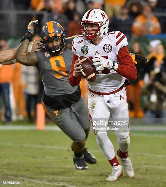 Derek Barnett of the University of Tennessee Volunteers chases quarterback Ryker Fyfe of the Nebraska Cornhuskers during the second half of the...