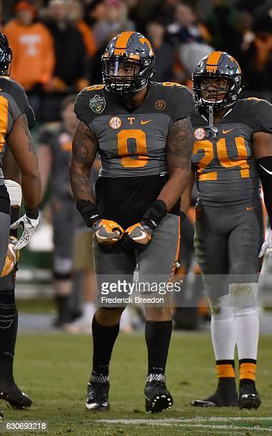 Derek Barnett of the University of Tennessee Volunteers flexes after making his 33rd career sack breaking the UT record held by Reggie White during...