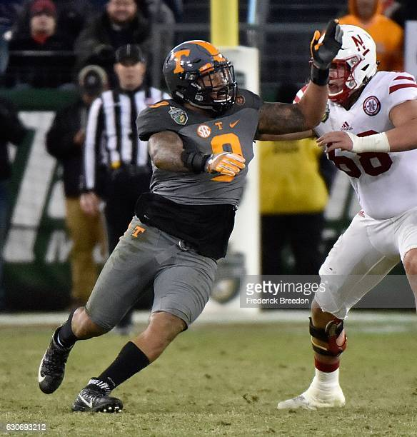 Derek Barnett of the University of Tennessee Volunteers rushes toward the quarterback of the Nebraska Cornhuskers during the second half of the...