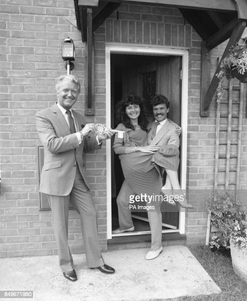 Derek Batey host of the TV quiz show Mr Mrs hands over the key to a 37500 Wimpey 'dream home' to Tony Capp and his 24yearold bride Lynda in Loddon...
