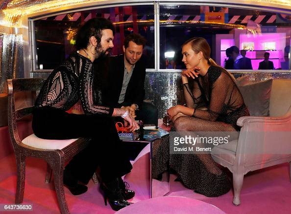 Derek Blasberg and Karlie Kloss visit the fortune teller at LondonÕs Fabulous Fund Fair hosted by Natalia Vodianova and Karlie Kloss in support of...