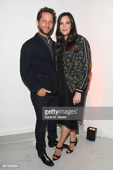 Derek Blasberg and Liv Tyler attend the Belstaff and Liv Tyler launch of Spring Summer 17 during London Fashion Week at Victoria House on September...