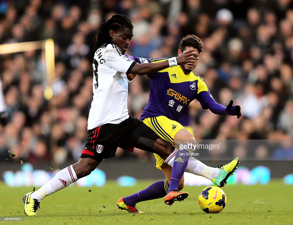 <a gi-track='captionPersonalityLinkClicked' href=/galleries/search?phrase=Derek+Boateng&family=editorial&specificpeople=535783 ng-click='$event.stopPropagation()'>Derek Boateng</a> of Fulham and Alejandro Pozuelo of Swansea compete for the ball during the Barclays Premier League match between Fulham and Swansea City at Craven Cottage on November 23, 2013 in London, England.