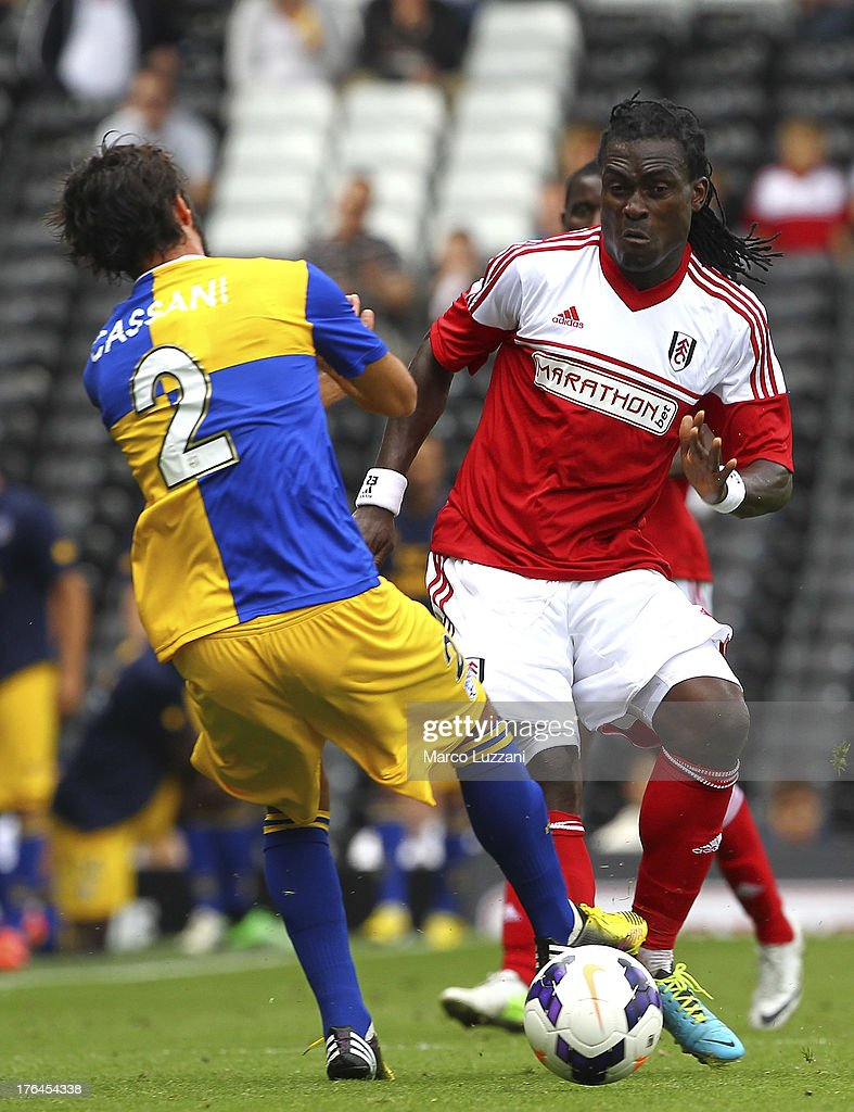 <a gi-track='captionPersonalityLinkClicked' href=/galleries/search?phrase=Derek+Boateng&family=editorial&specificpeople=535783 ng-click='$event.stopPropagation()'>Derek Boateng</a> (R) of Fulham FC competes for the ball with Jonathan Biabiany of Parma FC during the pre-season friendly match between Parma FC and Fulham FC at Craven Cottage on August 10, 2013 in London, United Kingdom.