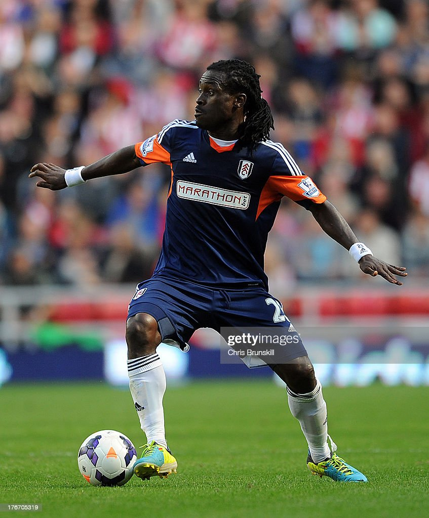 <a gi-track='captionPersonalityLinkClicked' href=/galleries/search?phrase=Derek+Boateng&family=editorial&specificpeople=535783 ng-click='$event.stopPropagation()'>Derek Boateng</a> of Fulham in action during the Barclays Premier League match between Sunderland and Fulham at the Stadium of Light on August 17, 2013 in Sunderland, England.