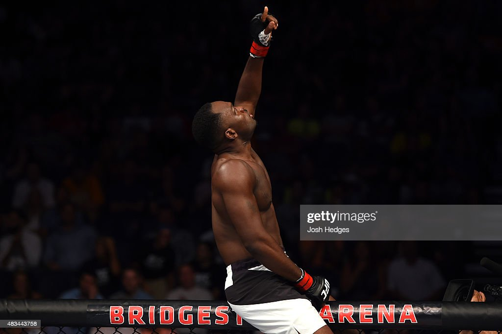 Derek Brunson celebrates after defeating Sam Alvey in their middleweight bout during the UFC Fight Night event at Bridgestone Arena on August 8, 2015 in Nashville, Tennessee.
