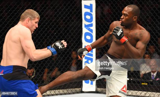 Derek Brunson kicks Daniel Kelly of Australia in their middleweight fight during the UFC Fight Night event at the Spark Arena on June 11 2017 in...