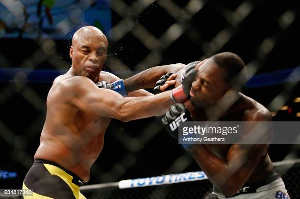 Derek Brunson of United States lands a punch against Anderson Silva of Brazil in their middleweight bout during UFC 208 at the Barclays Center on...