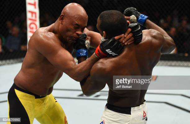 Derek Brunson punches Anderson Silva of Brazil in their middleweight bout during the UFC 208 event inside Barclays Center on February 11 2017 in...