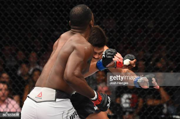 Derek Brunson punches Lyoto Machida of Brazil in their middleweight bout during the UFC Fight Night event inside the Ibirapuera Gymnasium on October...