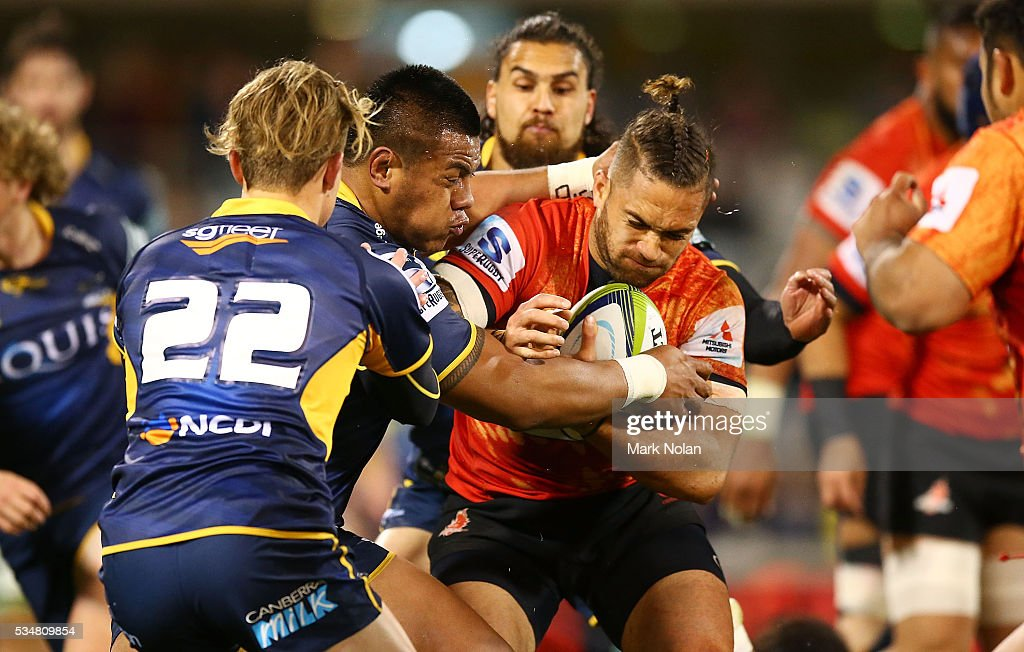 <a gi-track='captionPersonalityLinkClicked' href=/galleries/search?phrase=Derek+Carpenter&family=editorial&specificpeople=5534720 ng-click='$event.stopPropagation()'>Derek Carpenter</a> of the Sunwolves is tackled during the round 14 Super Rugby match between the Brumbies and the Sunwolves at GIO Stadium on May 28, 2016 in Canberra, Australia.