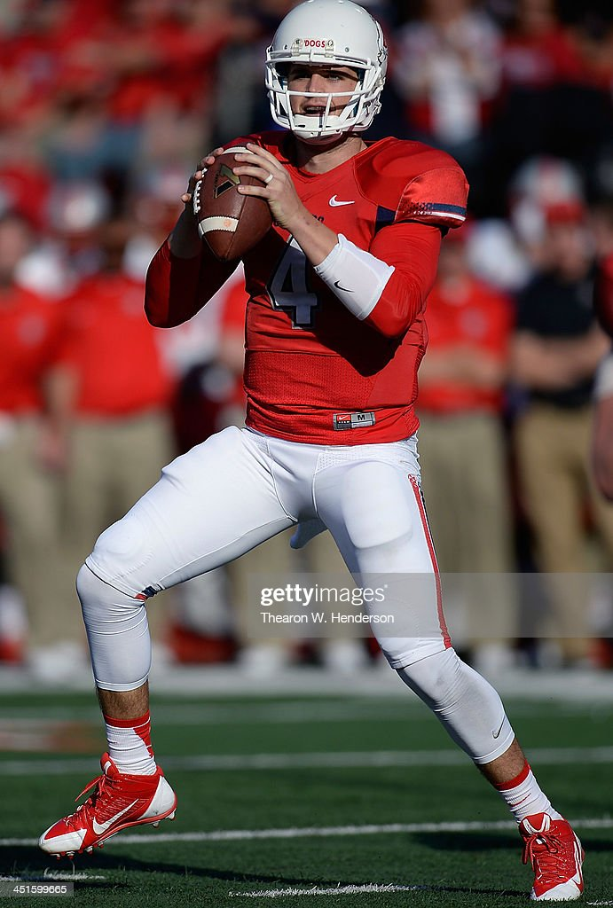<a gi-track='captionPersonalityLinkClicked' href=/galleries/search?phrase=Derek+Carr&family=editorial&specificpeople=8222798 ng-click='$event.stopPropagation()'>Derek Carr</a> #4 of the Fresno State Bulldogs drops back to pass against the New Mexico Lobos during the first quarter at Bulldog Stadium on November 23, 2013 in Fresno, California.