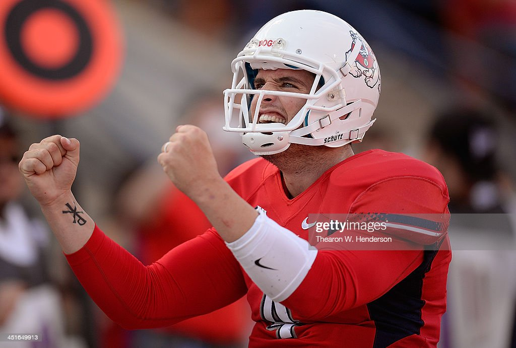 Derek Carr #4 of the Fresno State Bulldogs reacts after throwing his six touchdown pass of the day against the New Mexico Lobos during the third quarter at Bulldog Stadium on November 23, 2013 in Fresno, California. Fresno State defeated New Mexico 69-28.